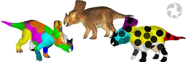 Trois modèles 3D de Vagaceratops irvinensis côte à côte, un de couleur brun orangé et les deux autres comportant des points noirs et des couleurs vives.